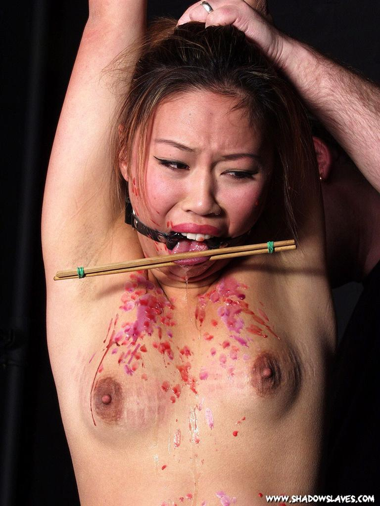 Kinky asian slut endures a nasty bondage session 10