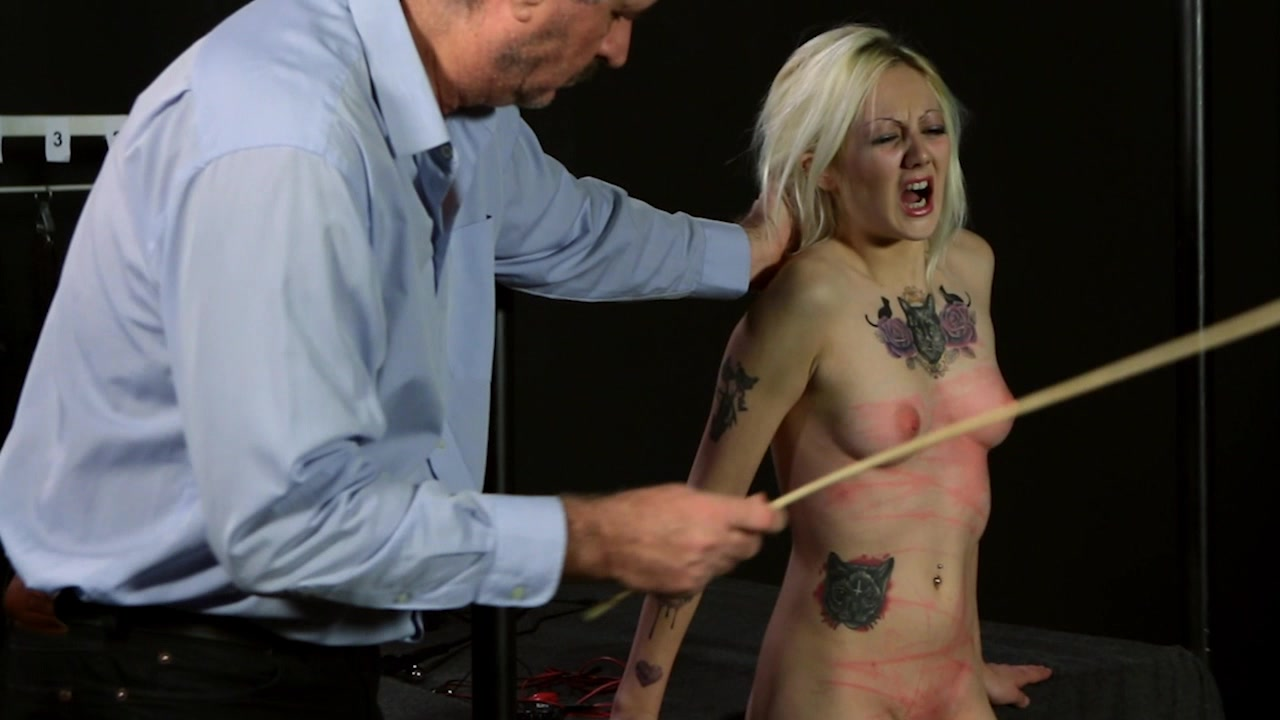 Gothic tattooed blonde in lingerie is playfully 6